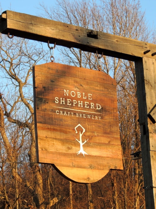 Wooden sign for Noble Shepherd Craft Brewery